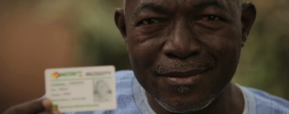 A Malian man with his insurance card