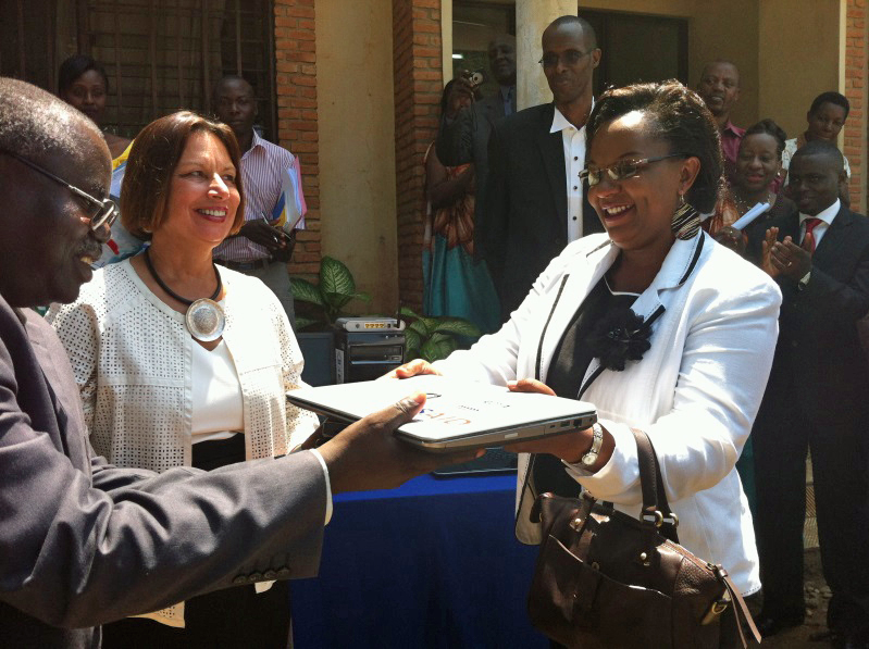 Minister of Health Dr. Sabine Ntakarutimana gives new IT equipment (purchased by HFG) to PNLS Director, Dr. Hilaire Ninteretse, watched by the US Ambassador to Burundi, Dawn Liberi.