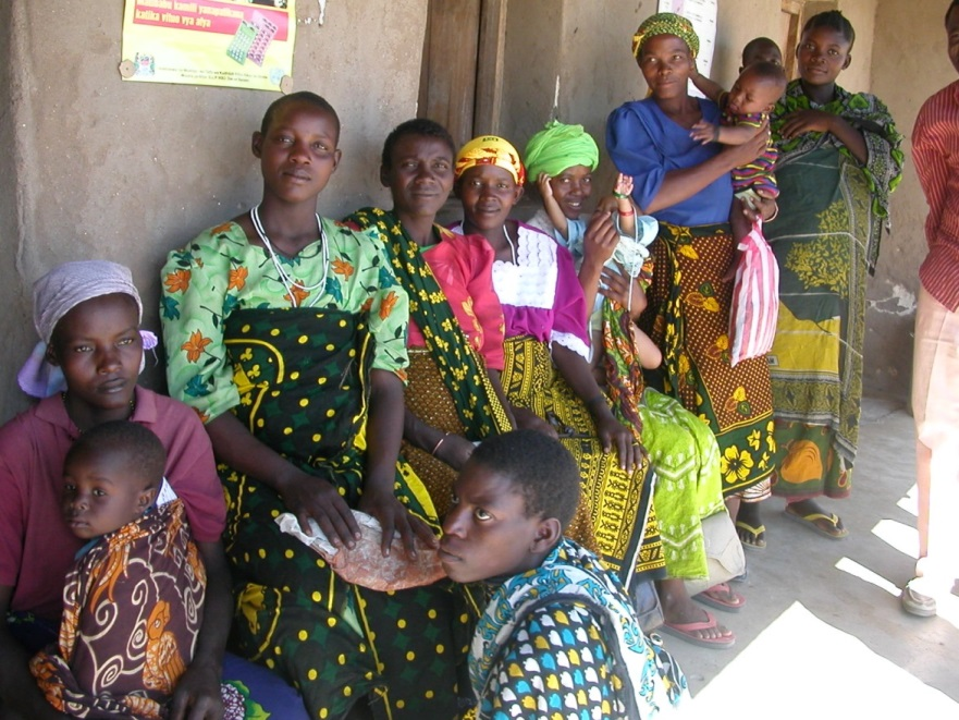 women and children wait for well-child services in rural Tanzania