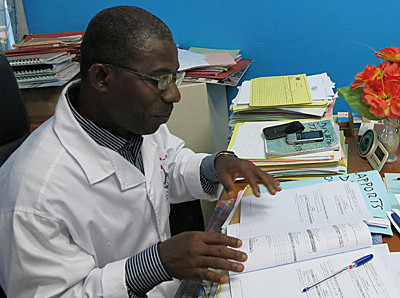 Male Health Worker in Ivory Coast Answers a Questionnaire