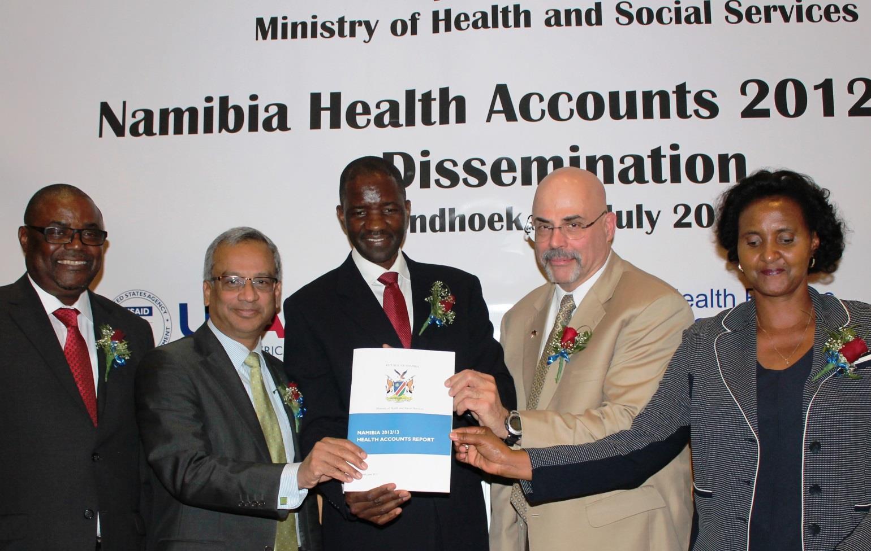 Page 6 Mr. P.K. NDAITWA, Prof. Monirul ISLAM, Hon Minister, Dr. Benhard HAUFIKU, Barry PRIMM, and Ms. Bertha KATJIVENA officially launch the 2012/13 Namibia Health Accounts report.