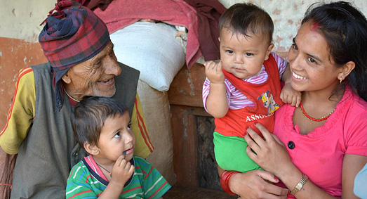 A Nepali mother with two young boys and their grandfather.