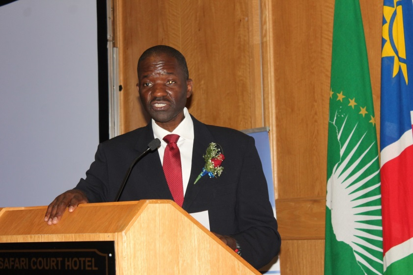 Minister of Health, Dr. Benhard Haufiku stands at a podium at the launch event in Windhoek.