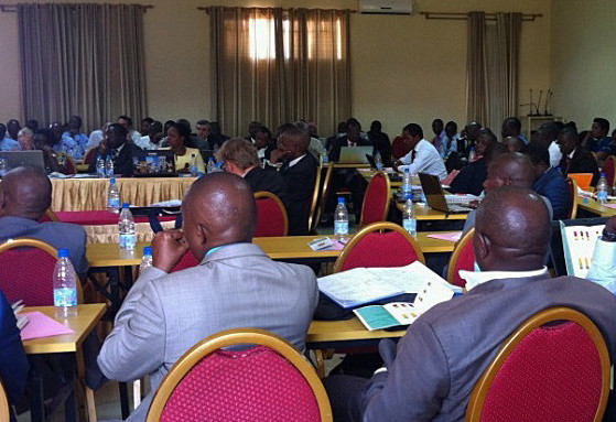 Participants at Burundi's Annual Health Sector Review in April 2015 listen to the findings of the 2012 and 2013 Health Accounts.