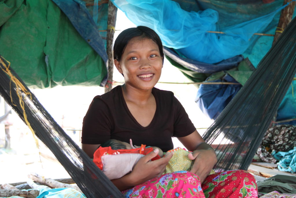A mother and child in Pursat Province, Cambodia. © 2013 Lina Kharn/University Research Co., LLC, Courtesy of Photoshare