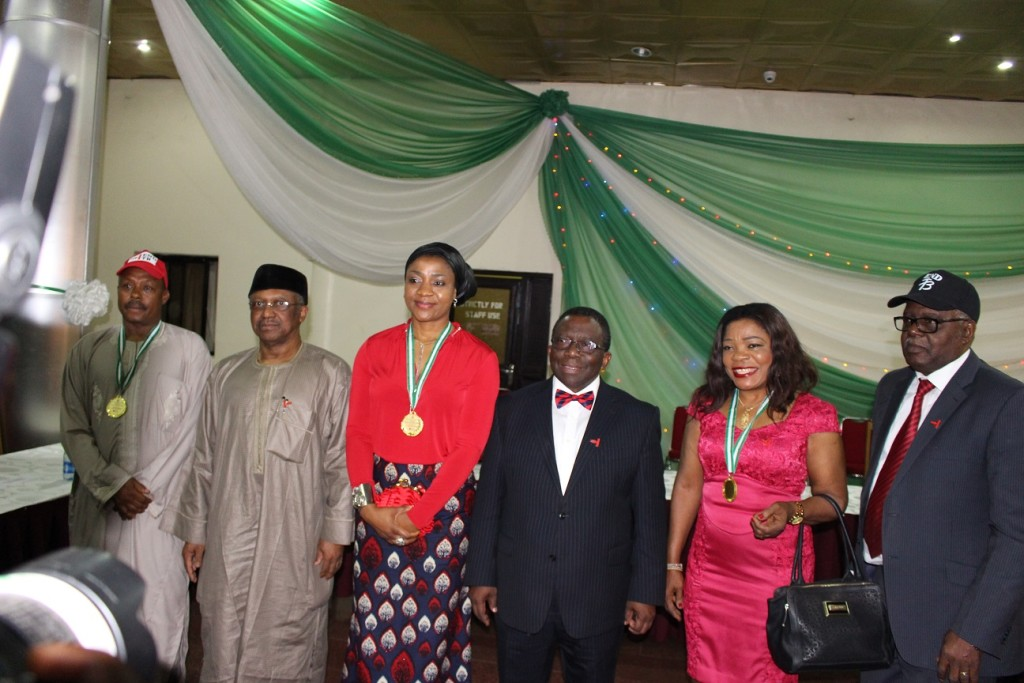 Minister of Health Adewole (right, center), and the TB Champion representative (left, center) and TB Advocates.